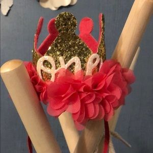 One pink and gold glitter crown
